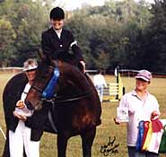 Ellen Holloman and Robinhood accepting the McClung Persimmon Preliminary Perpetual Trophy